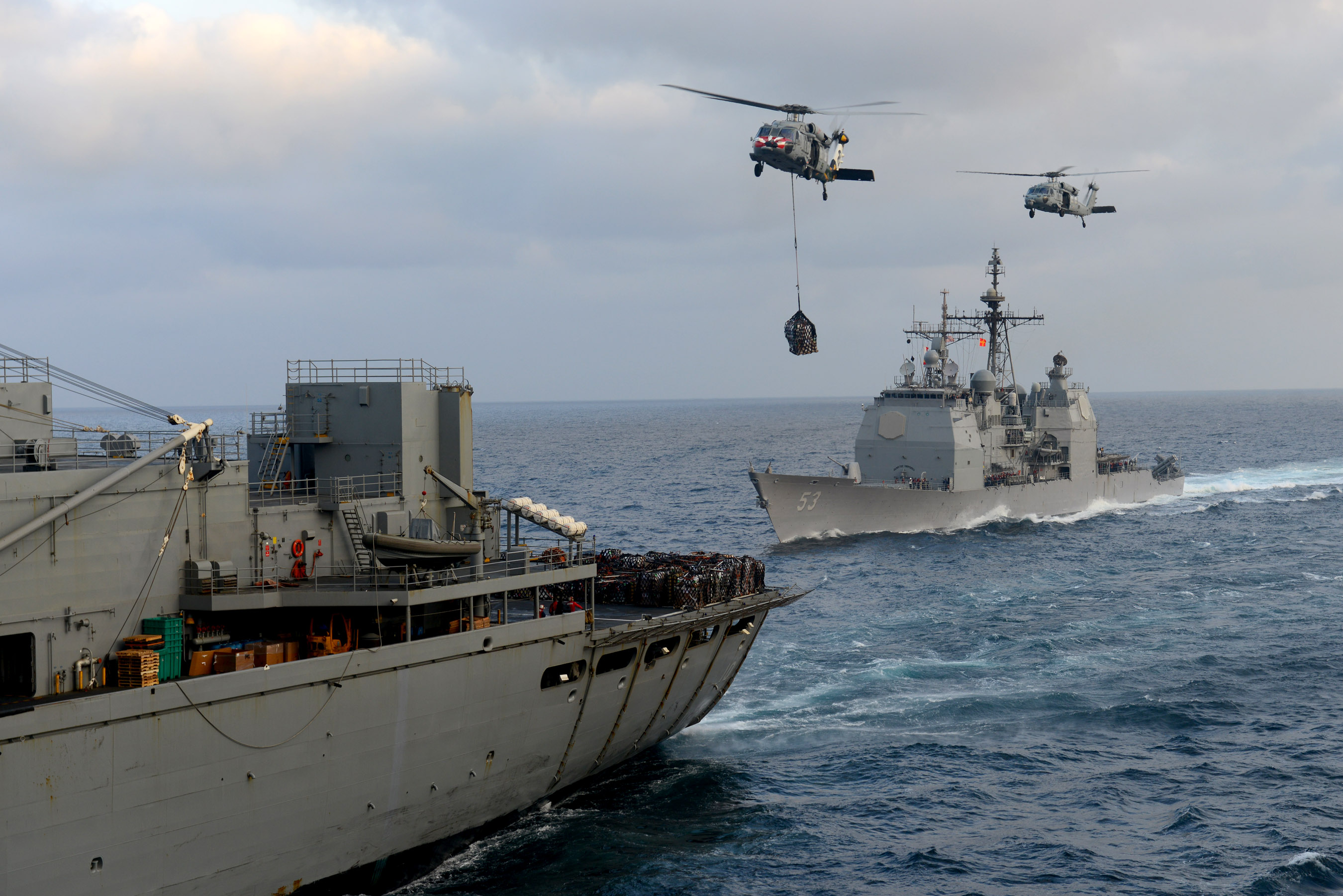 The cruiser USS <em>Mobile Bay</em> takes on supplies. <em>Photo: Navy</em>