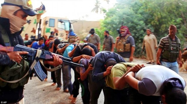 ISIS fighters round up captured Iraqi soldiers in Tikrit.