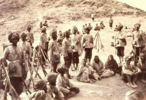 Photo of 45th Rattray's Sikhs with prisoners from the second Second Anglo-Afghan War. The three Afghan prisoners captured in the advance through the Khurd Khyber are sitting in the centre of the photograph, surrounded by Sikh guards. The 45th Sikh Regiment was raised in 1856 by Captain Thomas Rattray, and was popularly known as Rattray's Sikhs. It had earlier earned glory with its courage and loyalty to the British at the relief of Lucknow during the Indian Uprising of 1857. The Regiment served in the Fourth Infantry Brigade, part of the Peshawar Valley Field Force, during the Second Afghan War. The prisoners were lucky to have survived because in the harsh conditions and terrain of the Afghan Wars no quarter was given and prisoners taken, on both sides.