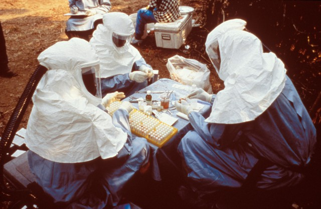 Scientists handle samples taken from animals near an Ebola outbreak in Democratic Republic of Congo.
