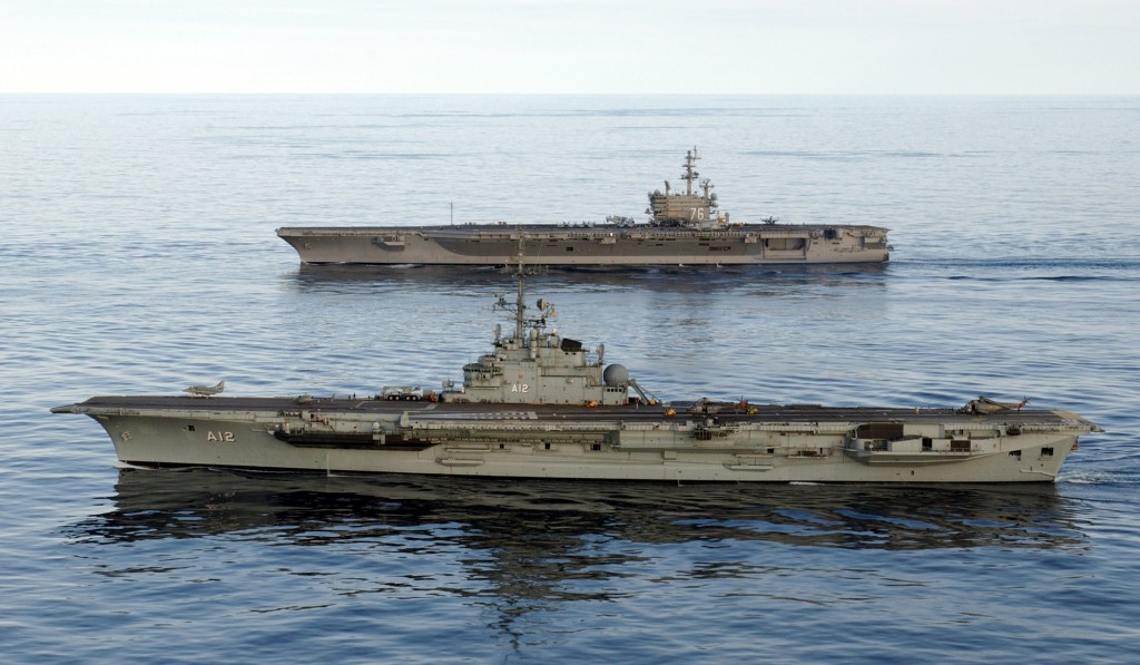 040608-N-1281L-009  Aboard USS Ronald Reagan (CVN 76), June 8, 2004 - Brazilian Navy aircraft carrier BNS Sao Paulo (A12), foreground, comes along side USS Ronald Reagan (CVN 76) as the ship transits around South America to its new homeport of San Diego. U.S. Navy photo by Photographer's Mate 1st Class John Lill. (RELEASED)