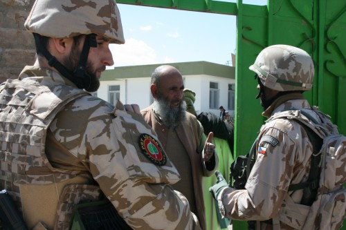 Lt. Jan Karasek from the Czech PRT is turned away from a school in Darvish, Logar, Afghanistan, March 30, 2011