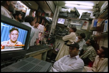Like at this electronics repair center in Islamabad, millions tuned in throughout Pakistan to hear President General Pervez Musharraf speak to the nation. He was giving a televised address to explain Pakistan's role in assisting America's