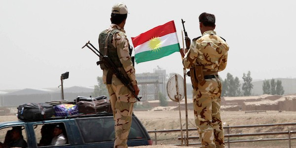 Members of the Kurdish security deploy on the outskirts of Kirkuk June 11, 2014.