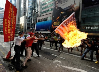 A burning American flag during an anti-Japan riot in Hong-Kong, September 16, 2012. (Photo: Antony Dickson / AFP / Getty Images).