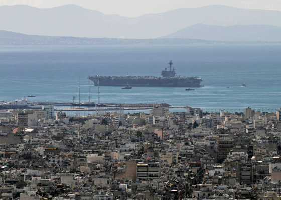 The USS George H.W. Bush (CVN-77) anchors off the coast of Piraeus, Greece, 04.03.2014.