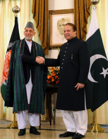 Pakistani Prime Minister Nawaz Sharif shaking hands with Afghan President Hamid Karzai before their meeting at Sharif's house in Islamabad. Karzai had arrived in the capital of Pakistan for a daylong visit on 26 August 2013. According to officials and diplomats, the talks focused on Pakistan's role to bring the Taliban to the negotiation table.