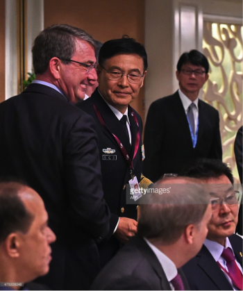 Sun Jianguo (C) from the Chinese People's Liberation Army Navy and US Secretary of Defense Ashton Carter (L) attend the ministerial luncheon at the 14th Asia Security Summit, the International Institute for Strategic Studies (IISS) Shangri-La Dialogue 2015 in Singapore on May 30, 2015.