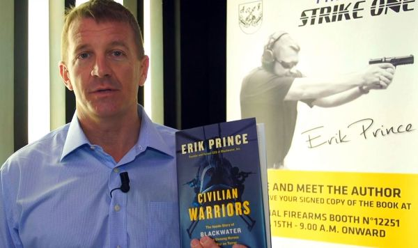 "Eric Prince with his book ""Civilian Warrior"""
