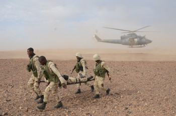 A Canadian Special Operations Forces CH-146 helicopter helps train Mauritian troops to evacuate casualties during Exercise Flintlock 2014 (Photo: U.S. Africa Command).