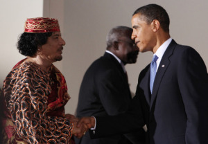 U.S. President Barack Obama shakes hands at the G-8 summit with a visiting Muammar al-Qaddafi .