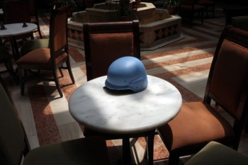The helmet of a UN observer sits in the lobby of a hotel in Homs, Syria, May 19, 2012 (Photo by David Degner/Getty Images).
