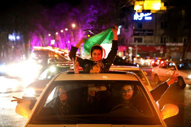 After Iran's nuclear agreement with world powers in Lausanne, Iranians celebrate on a street in northern Tehran, perhaps because the deal was presented to the people as a victory for the Iranian government (Photo: Ebrahim Noroozi).
