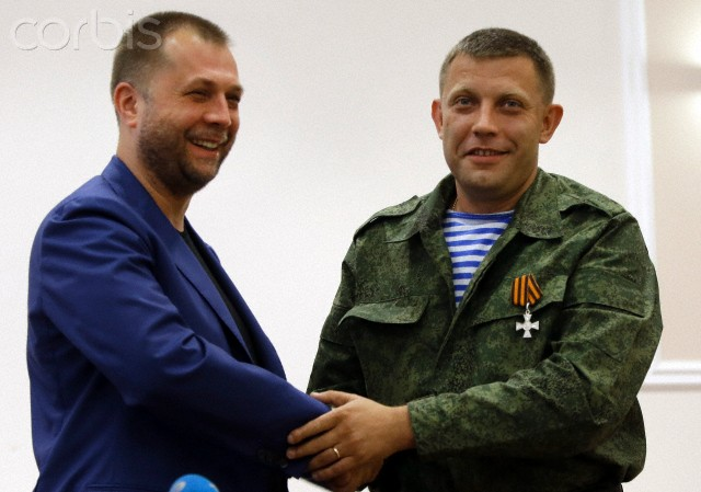 "Outgoing 'Prime Minister' Alexander Borodai, left, shakes hands with Alexander Zakharchenko, who has been put forward as the new 'Prime Minister' of the self-declared ""Donetsk People's Republic"", after a press conference in Donetsk, eastern Ukraine, Thursday August 7, 2014. Alexander Borodai announced he was resigning Thursday and that he would act as an adviser to Zakharchenko, once he has been confirmed by the separatist legislature ( Photo: Sergei Grits)."