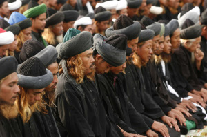 Members of an exclusive Muslim community who call themselves An-Nadsir attend prayer to celebrate Eid al-Adha in a remote area in Gowa district, in Indonesia's South Sulawesi province, December 8, 2008. (REUTERS/Yusuf Ahmad)