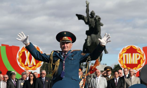 Military conductor of Moldova's self-proclaimed separatist Dnestr region takes part in a military parade during the celebration of 20 years of self-styled independence in Tiraspol on September 2, 2010 (Photo: Vadim Denisov).