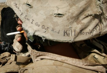 "Lyrics from a Misfits song, ""Mommy, Can I Go Out And Kill Tonight?"" decorate the helmet of Marine Cpl. Jonathan Eckert of Oak Lawn, IL attached to India Battery, 3rd Battalion, 12th Marine Regiment while on patrol near Forward Operating Base (FOB) Zeebrugge on October 15, 2010 in Kajaki, Afghanistan. The Marines of India Battery, 3rd Battalion, 12th Marine Regiment are responsible for securing the area near the Kajaki Dam on the Helmand River (Pfoto: Scott Olson / Getty Images)."