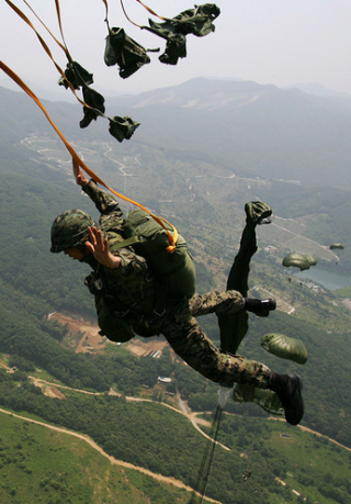 South Korea special warfare command troops during a paradrop and training exercise from a CH-47 Chinook helicopter during their parachute drill at military base on June 27, 2009, in Geangju, South Korea. The drill follows high-level security talks between USA and South korea after North Korea's nuclear test  and long-range rocket launch in 2009.