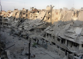 Buildings in besieged Homs slump following shelling on October 7, 2012. (Photo: Shaam News Network/AFP)
